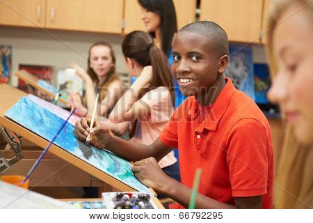 Male Pupil In High School Art Class
