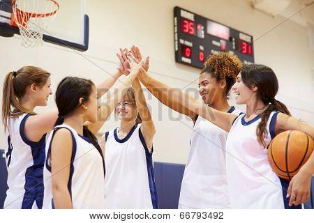 Female High School Basketball Team Having Team Talk