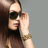 stock photo of brown-haired  - Beauty Fashion model girl with long brown hair wearing stylish sunglasses - JPG