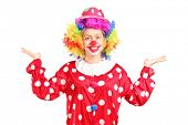 stock photo of clowns  - Female clown gesturing with hands isolated against white background - JPG