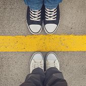 foto of legs apart  - Sneakers from above - JPG