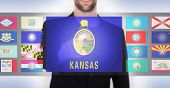 foto of kansas  - Hand pushing on a touch screen interface choosing a state Kansas - JPG