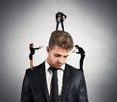 stock photo of obey  - Concept of stressed man due to colleagues - JPG