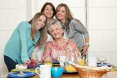 stock photo of grandma  - Family breakfast with grandma - JPG