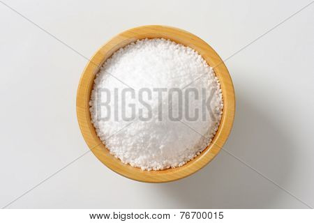 portion of coarse salt in the wooden bowl