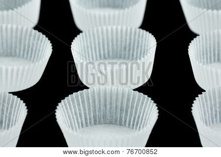 Cookie paper cases isolated on black