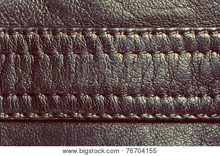 Genuine vintage leather with seam. Background, pattern, texture.
