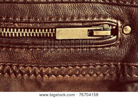 Wardrobe, clothing element, genuine brown leather with zip and seam. Background, pattern, texture.