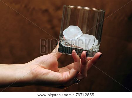 Glass With Ice In  Hand