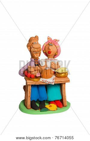 Statuette Of A Husband And Wife At The Table With Food