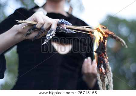 Witch burning medicinal herbs
