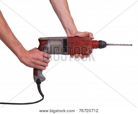 Man's Hands Holds A Brown Drill