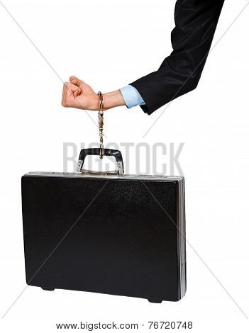 Hand In Black Suit With Handcuffs Chained To The Black Case