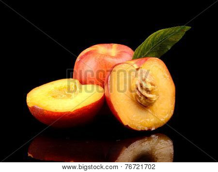 Few Sliced Nectarines With Leaf Isolated On Black
