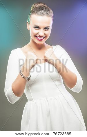 Portrait Of Caucasian Brunette Woman Showing Emotional Excitement With Lifted Hands