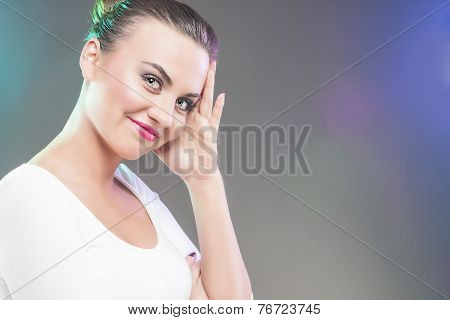 Smiling Happy Smiling Caucasian Brunette Woman Touching Head. Over Gray