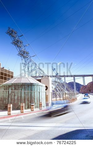 Row Of Cars Passing By Over The Hoover Dam In The Afternoon