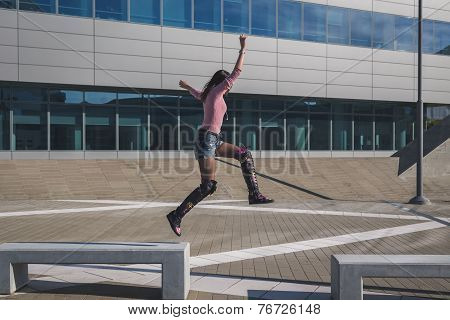 Beautiful Young Brunette Jumping In The City Street