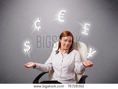 pretty young lady sitting and juggling with currency icons