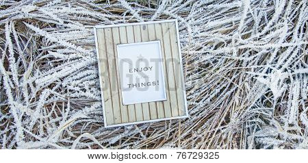 Old Wooden Frame Over Frozen Grass. Enjoy Little Things
