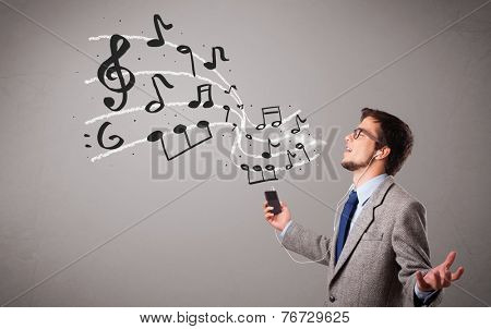 handsome boy singing and listening to music with musical notes getting out og his mouth
