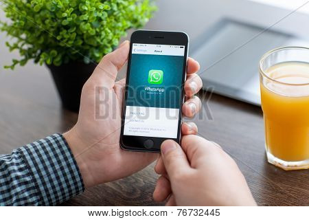 Man Holding Iphone 6 With Whatsapp On The Screen