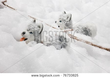 Christmas Decoration With Two Plush Dogs Alaskan Malamute In The Snow
