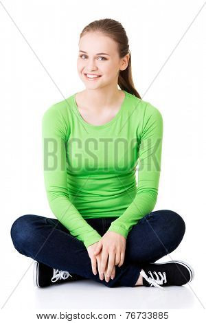 Happy laughing woman sitting cross-legged.