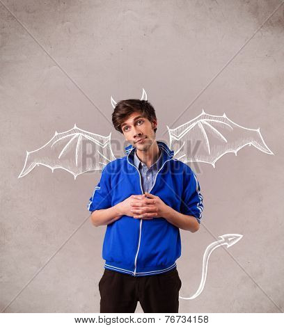 Young nasty man with devil horns and wings drawing