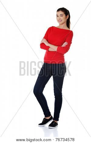 Full length woman posing with folded arms.