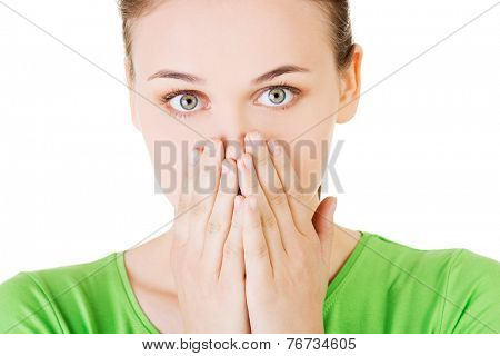 Student woman covering her mouth because of shame.