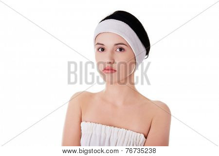 Portrait of a woman with white band on head.