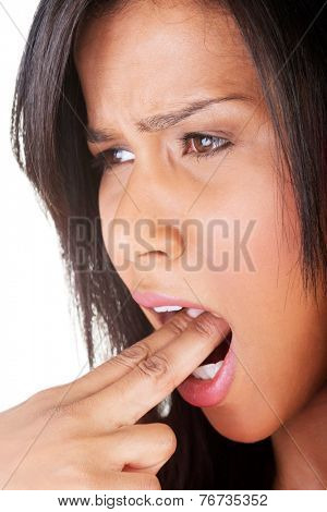 Portrait of young woman provoke vomiting.