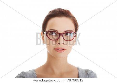 Portrait of a woman in eyewear looking up.