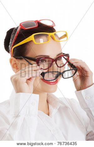 Portrait of a woman wearing many eyewear.