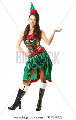 Full length woman wearing elf clothes, holding something invisible.