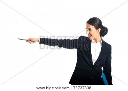 Happy businesswoman pointing to the left by pen.