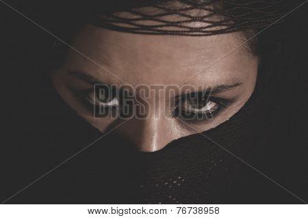 India, woman in traditional Islamic veil, burka, beautiful and deep look