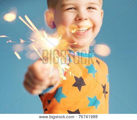 Smiling boy holding fireworks