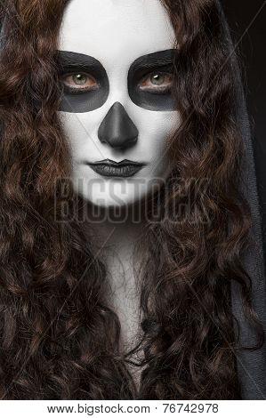 Girl make up a skull