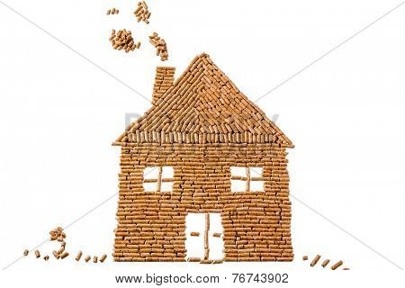 a house built of pellets for heating. alternative and sustainable energy for heating