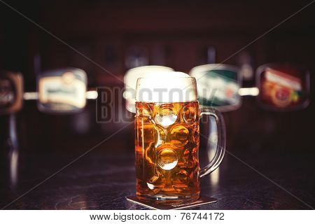 Beer Glass On A Bar Table. Closeup