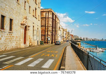 NAPLES, ITALY - JULY 3, 2007: Car rides along the promenade of Naples. Naples is the third largest city of Italy, located 230 km south of Rome, on the Tyrrhenian Sea, not far from volcano Vesuvius.