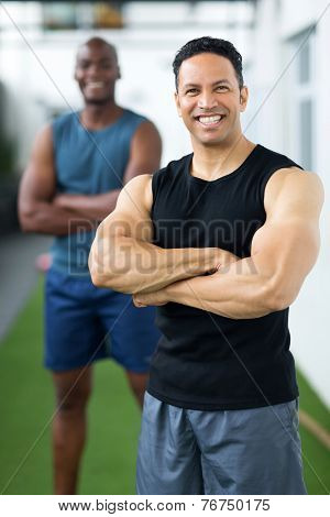 good looking middle aged trainer standing in front colleague