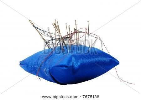 Pincushion with needles and threads