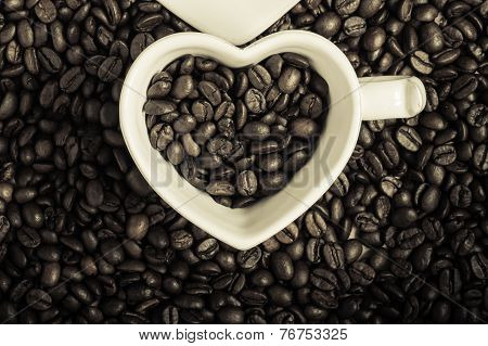 White Cup On Coffee Beans Background