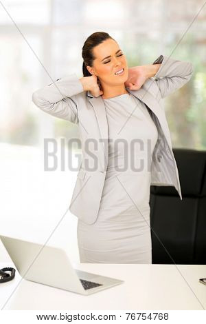 stressed businesswoman having neck pain