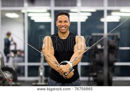 strong middle aged man doing triceps exercise