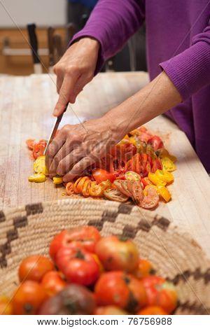 Heirloom Tomatoes Being Cut