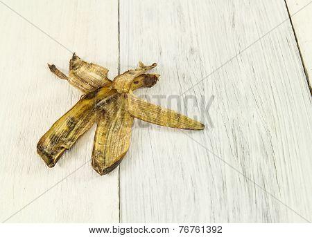 Banana Peel On Wooden Background